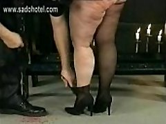 German master hits dirty fat gimp in his dungeon on her huge ass with a lash