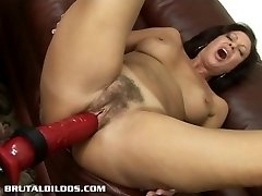 Brunette Hair milf is fucked hard by a brutal sex toy machine