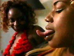 Ebony lesbian long tongue smooching