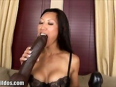 Busty asian rides a enormous brown brutish dildo