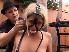 Trussed up platinum-blonde in bondage