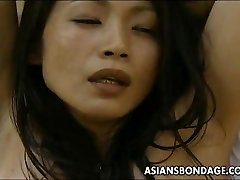 Asian tramp roped up so the man can drill her