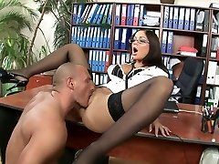 Smoking hot brunette with glasses rides her chief in his office