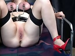 Thick brunette bdsm slut in lingerie gets her clean-shaved pussy and tits manhandled