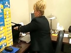 tall mature lady in office with  her sole victim