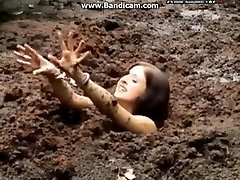 Manacled damsel gets stuck in deep mud