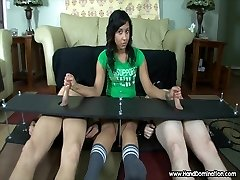 teen gives femdom handjob to 2 cocks in bondage