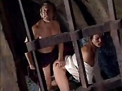 Lady abused in cell by jailer in front of her bound up husband