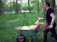 Young slave get strapped up and fucked in the garden
