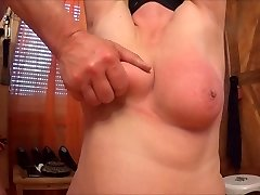 spanking and slapping her tits