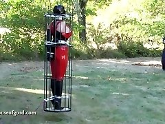 latex bondage dame jewell caged and stored in silo