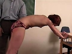Curvy redhead schoolgirl Betty gets her wazoo spanked throughout her panties in the classroom