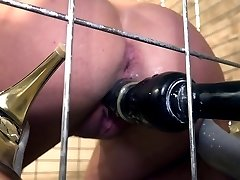 Lola Wan infirm in a cage bound gagged dildoed and vibed