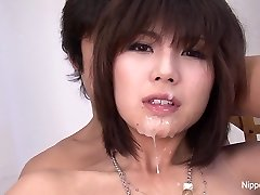 Japanese sweetie gets her face & globes showered with jizz