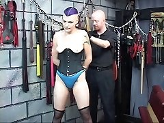 BDSM goth chick gets corded, spanked and nipples clipped by two men in chamber