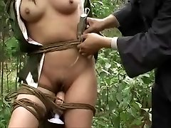 Chinese army lady tied to tree 3