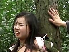 Chinese army dame strapped to tree 2