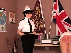 Police domina paddles fucking partner over desk