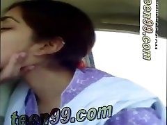 Indian couple smooching hard in the truck