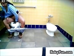 Yam-sized Indian Peeing On A Toilet