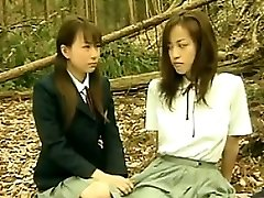 Excited Oriental Lesbians Outside In The Forest
