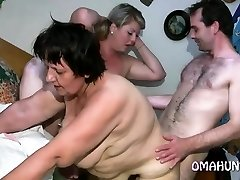 Horny mom enjoys girl/girl fun in bed