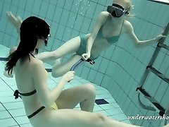 Two splendid babes swimming in a pool in arousing Underwater show