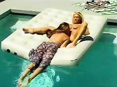 2 lesbians having joy at the pool