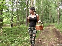 Stacked girl-girl babe Rachel Evans is having some naughty fun in the woods
