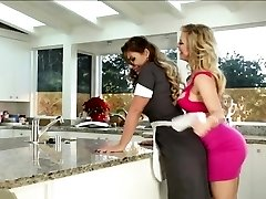 Lesbians licking cookie in the kitchen