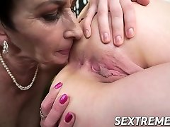 Grubby Lucette slurps her granmas pussy