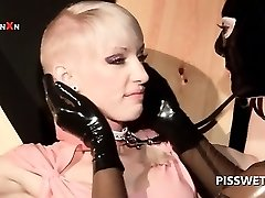 Sub in latex gets twat finger fucked for piss in BDSM 3some