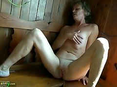 Horny grannie with flat tits fingering her pussy in sauna