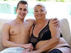 Humungous grandma's tits covered with jizz