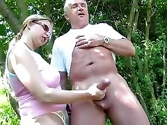 Mature duo outdoors and she gives him a handjob of the fuckpole