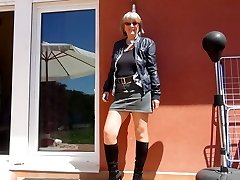 Gorgeous granny in shoes and nylons
