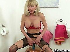 British granny Elaine fucks a dildo on toilet
