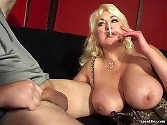 Big-boobed mom gives oral pleasure and smokes cigarette