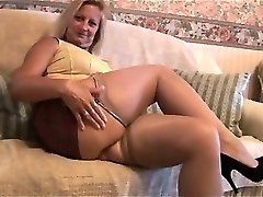 Mature blonde with great body in tight mini miniskirt