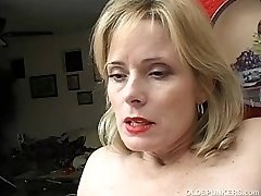 Super sexy older dame in crimson plays with her wet pussy