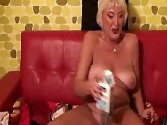 Mature Granny pouring Milk down her twat.