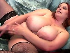 Mature mom with VERY BIG TITS and her rubber stiffy