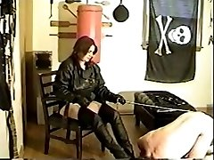 Mature domme in latex boots