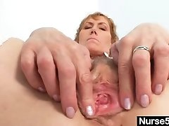 Senior mom self exam on gynochair with butt-plug