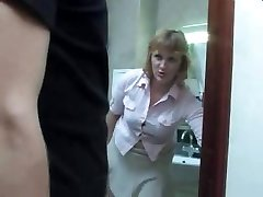 Mature mom takes a piss on the toilet and gets interrupted by her sonnie for a fuck
