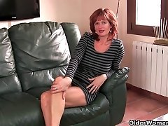 Redheaded mature mummy plays with her nips and pussy