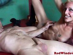 Skanky redlight hooker guzzles some cum