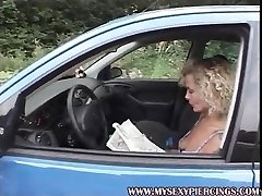 MILF with pierced twat and nipples masturbating in the car