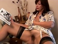 Busty hairy mature black-haired stunner poses and strips