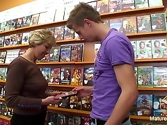 Fantastic blonde mature pounds him in the video store